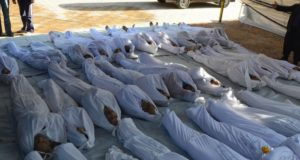 Syrian-activists-inspect-bodies