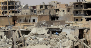 Damaged buildings are pictured during the fight between Syrian Democratic Forces and Islamic State fighters in Hisham Bin Abdelmalik, a district of Raqqa